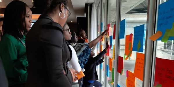 Young people looking at post it notes